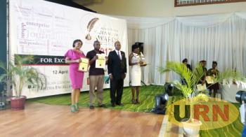 Dr Louis Kasekende poses for a photo with one of the award winners