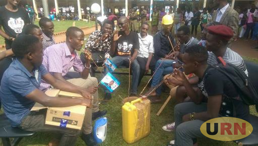 Some students at Mitchell Hall drinking Malwa, a locally-made brew, during guild campaigns recently.