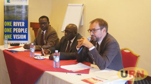 Nile Basin Intiative Executive Director, Innocent Ntaban(L) and participants at a meeting in Entebbe