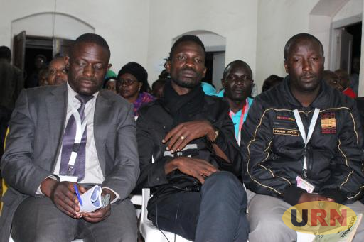 Bobi Wine seated in the middle at the election tally centre in Kasangati on Thursday.