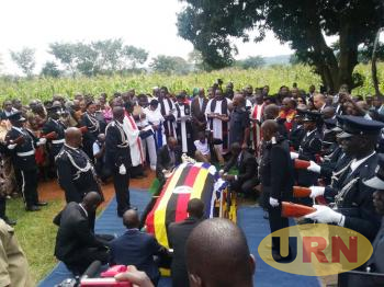 The casket containing the body of RIPE Sam Owori being lowered in the grave at Kidera,Tororo