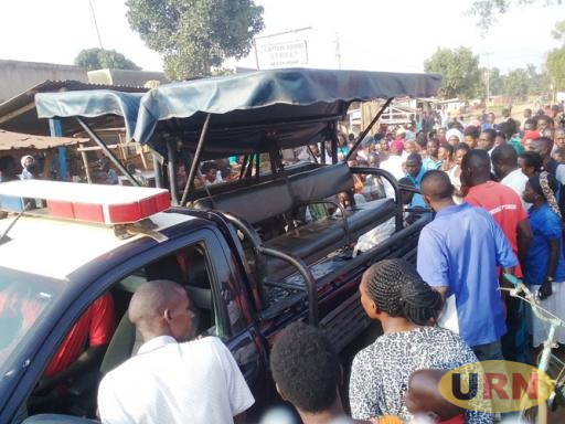 The dead body of Shadia Namutebi being loaded on Police truck for transfer to Mulago Hospital Mortuary for postmortem