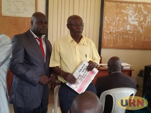 Daniel Baguma wearing red necktie with Rakai NRM official. Baguma faces removal from Kyotera district ahead of election