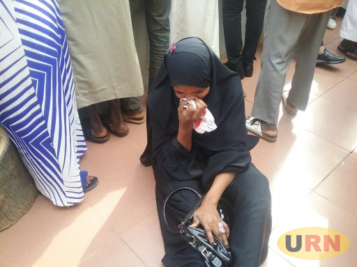 A muslim llady crying on the floor at High Court today after Court awaded death sentence to four Muslim Clerics
