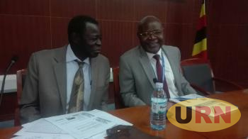 UBOS Director of Macroeconomic Statistics Dr Chris Mukiza (R) and the Principal Statistician Vincent Musoke Nsubuga at the release of the Consumer Price Index for September 2017.