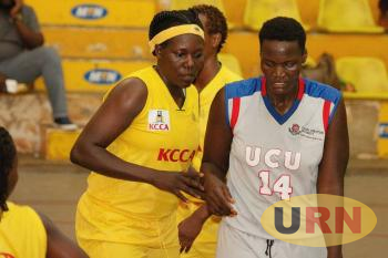 KCCAs Martha Soigi Plays defense on UCUs Vilma Achieng in the Friday games