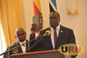 Justice owing Dollo taking oath