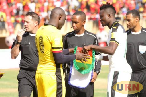 Match officials who handled the Uganda - Ghana game together with the two captains.