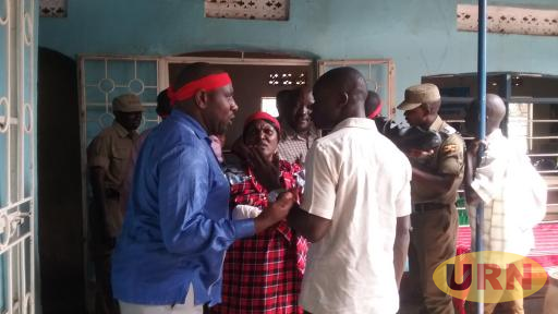 Cadet ASP Charles Denaya (in white shirt) tussles with FDC supporters in Moroto at Salo Angels this afternoon.