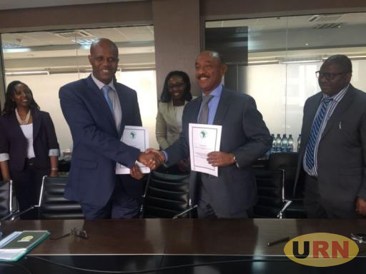 EAC Secretary General Amb. Liberat Mfumukeko with Gabriel Negatu, Director General of the African Development Bank East Africa Regional Resource Centre (EARC) at the signing ceremony in Arusha,