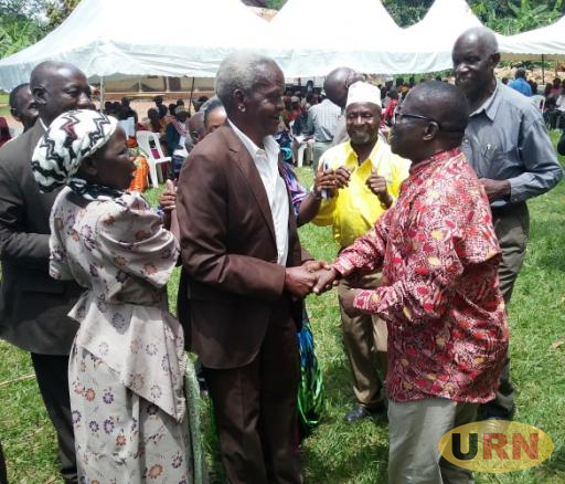 MP Abraham Byandala hugging NRM Leaders at Butuntumula sub county recently