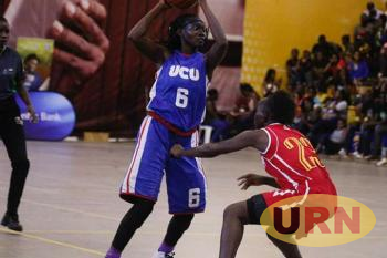 UCU's shooting guard Judith Nansobya Ayoo in action in a game againts KCCA