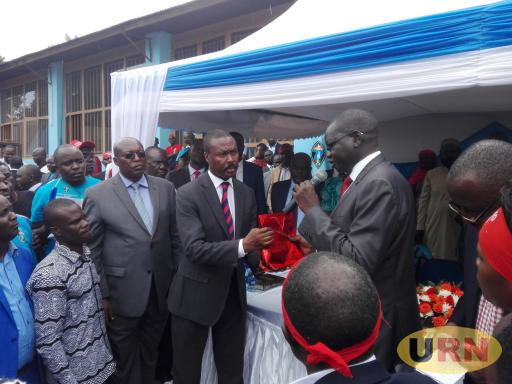 Patrick Oboi Amuriat popularly known as POA hands over gift to his predecessor Maj. Gen (Rtd) Mugisha Muntu