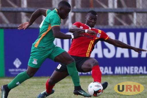 Uganda Hippos defender battling against Zambia in the opening game.