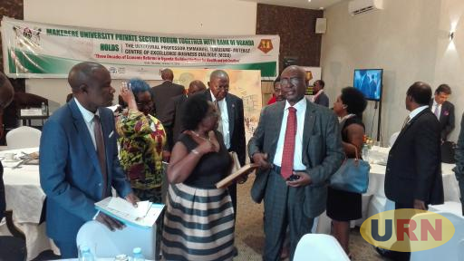 Prof. Mutebile (C) flanked by his wife Betty and Dr Kaberuka