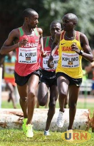Jacob Kiplimo (R) warming up ahead of the 2017 IAAF World Cross Country Championships in Kampala.