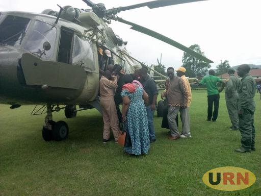 Some of  NRM leaders lifting,Christopher Mulenga into a UPDF Chopper
