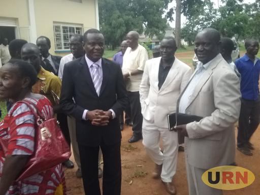 Mp Felix Okot Ogong interacting with a group of some clan chiefs soon after the meeting