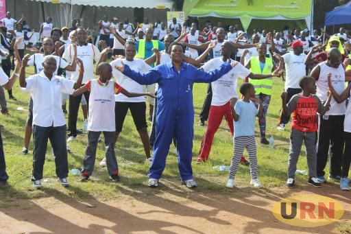 Minister Mutuuzo together with the OSH marathin participants cool down after the 10km and 6km runs and walks