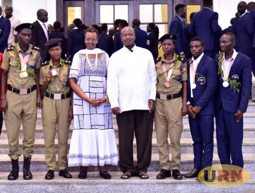 President Yoweri Kaguta Museveni, First Lady and Minister of Education and Sports, Janet Kataaha Museveni and the five medal winners at the Commonwealth Games on Sunday during the luncheon.