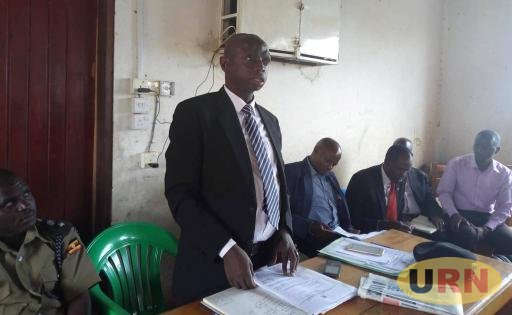 Masaka Deputy RDC Joseph Ssekasamba, chairing a stakeholders meeting at Williams Hill Primary School that is under dispute.jpg