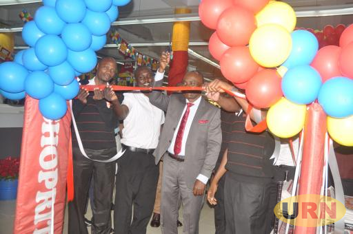 Commissioner in charge of trade at the Ministry of Trade and Industry Raymond Agaba while launching Shoprite Entebbe branch