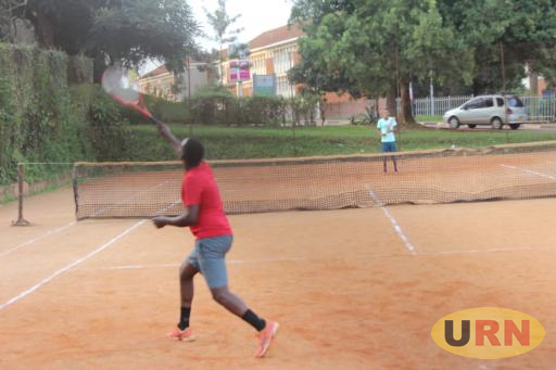 A man playing Tennis at Makerere University Guest House
