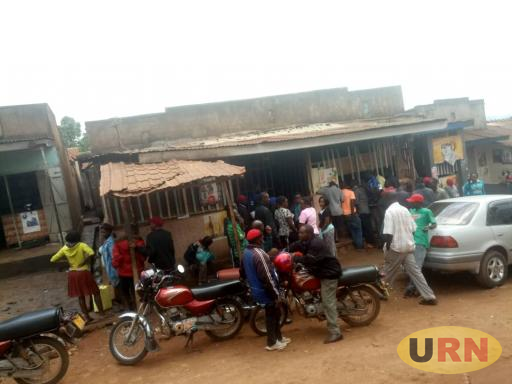 Locals gather at one of the bars in Kifumbira - Kamwokya Slum to conduct Local Council One elections