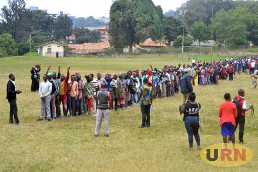 Bagonza and his voters at during the polling at Makerere University Rugby Grounds