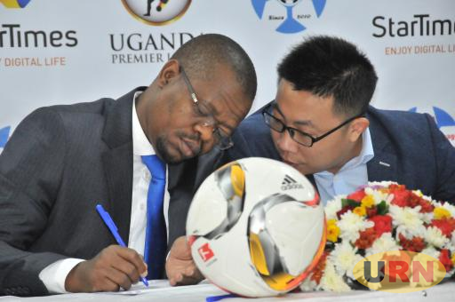 FUFA President Moses Magogo (L) and StarTimes CEO Andy Wang during the unveiling.