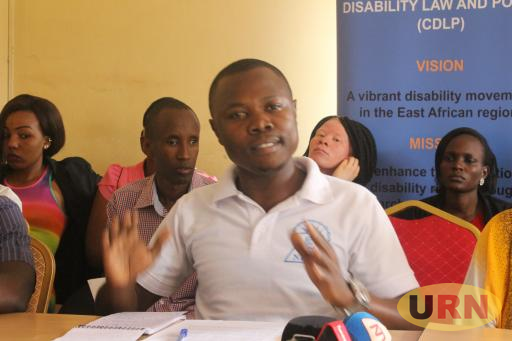 David Nangosi, the NUDIPU legal assistant, and focal person for on Sustainable Development Goals –SDGs addressing press at NUDIPU offices in Kisaasi Kampala on Sunday