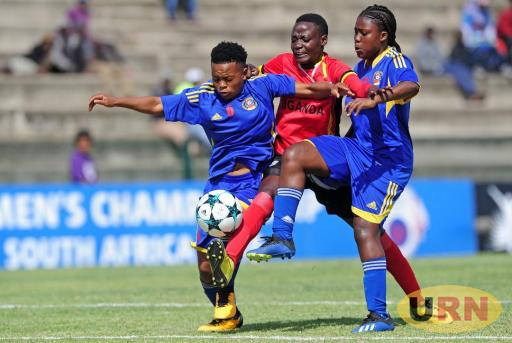 Uganda Crested Cranes player battles through Swaziland players on Wednesday.