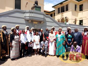 The Family of Kiwanuka , Justices and the Vice President Sekkandi Pause below the New erected Bust of Benedicto Kiwanuka in Kampala