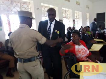 A police officer battling, Elison Twinamatsiko, the district councilor  representing Maziba sub county