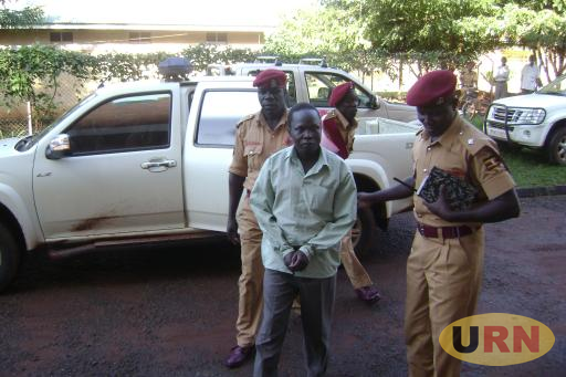 Thomas Kwoyelo being brought to court
