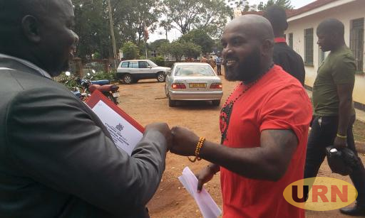 Eddy Mutwe with Lawyer Tony Kitara after Being Released By the High Court in Gulu