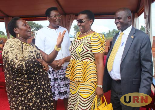 Talking Oil with Bunyoro Energy and Mineral Development Minister, Irene Muloni in Shades. Left is MP Jalia Bintu Lukumu looking on in yellow necktie is Bunyoro Affairs  Minister, Earnest Kiiza
