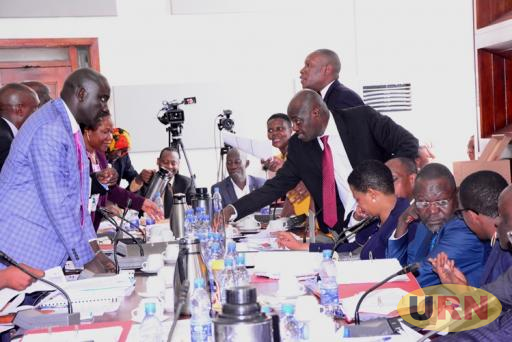 Central Bank Staff and a section of MPs in a discussion over sale of loans during a committee break.