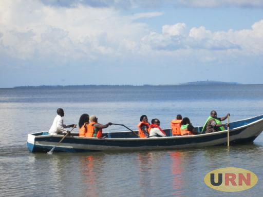 People moving in a small boat on Lake Victoria