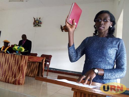 Florence Musimenta, the district female workers' representative  swearing in
