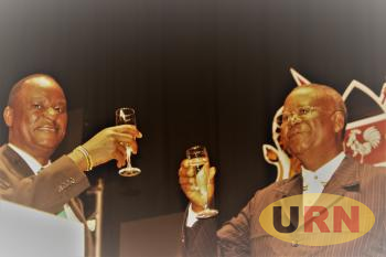 Kenyan High Commissioner to Uganda,  Kiema Kilonzo (L) toasts with Tourism Minister, Professor, Ephraim Kamuntu