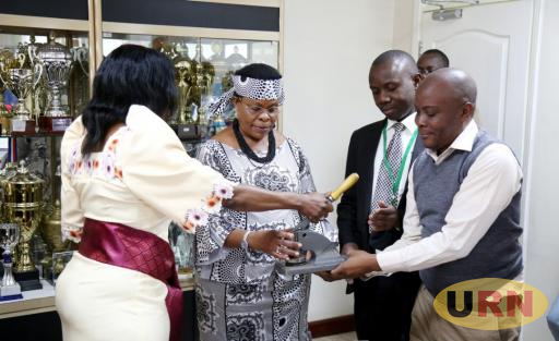 KCCA Minister Beti Kamya receiving documents from Jenniffer Musisi today