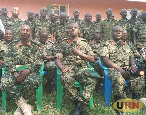 The CDF Gen David Muhoozi (Middle Front Row) and Outgoing Commander 4th Division Brigadier Emmanuel Kanyesigye  (R) and Incoming 4th Division Commander Col Bonny Bamweseki (L)