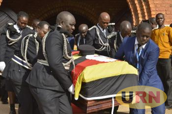 Police Carrying Kakooza's Casket this afternoon