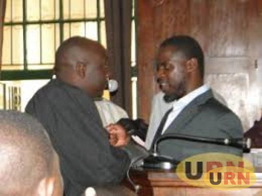 Dr Ismail Kalule talking with his lawyer during the 2010 July twin bombing trial