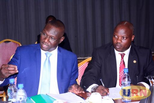 National Council for Higher Education (NCHE) officials Arthur Muguzi and Pius Achianga before the Education Committee.