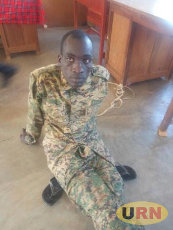 Private Isaac Newton Okello who has bee  charged with four miser countS