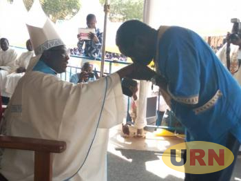 Bishop Linos Wanok being greated by the Former Lands Minister Daniel Omara Atubu soon after his installation