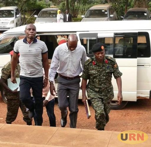 Colonel Atwooki Ndahura in military uniform arrives at the General court martial with his co-accused for his bail application ruling