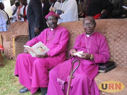 The late Rt. Rev. Cyprian Bamwoze (in glasses) attending the burial of the late Joyce Mukungu, the former wife of the UCU Librarian Dr Fredrick Mukungu in Kibeto village in Kamuli in 2015
